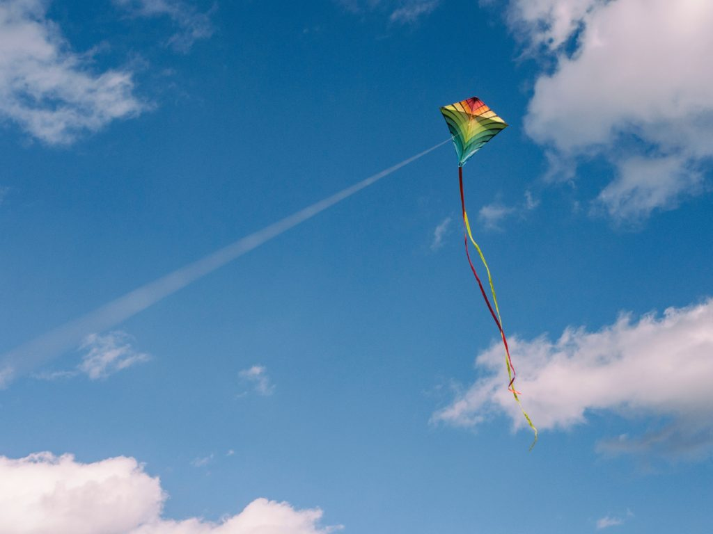 Kite flying in the sky. Flying a kite requires manual dexterity and hands-on practice