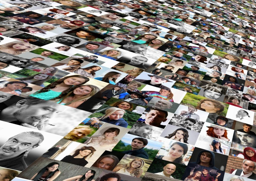 Collage of photos, mostly headshots, or many different people. The collage is angled to show that the photos go on and on into the distance, suggesting a feeling of infinite variety.